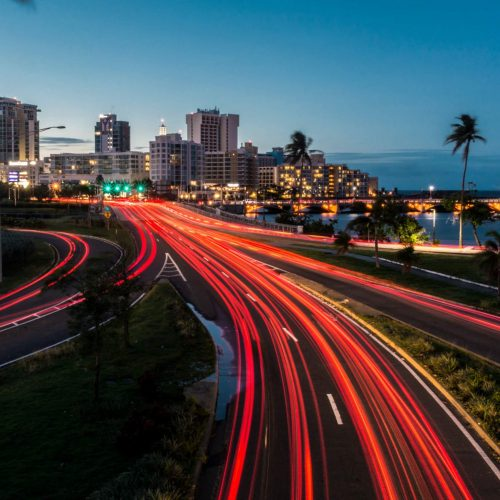 Traffic entering the capital of Puerto Rico at night.; Shutterstock ID 1100207690; Job: NL-Comercial Q4; Client/Licensee: Banco Popular; Other: Comercial